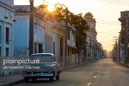 Street scene at sunrise with vintage American car, Cienfuegos, UNESCO World Heritage Site, Cuba, West Indies, Caribbean, Central America