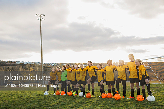 Girls soccer team standing on field