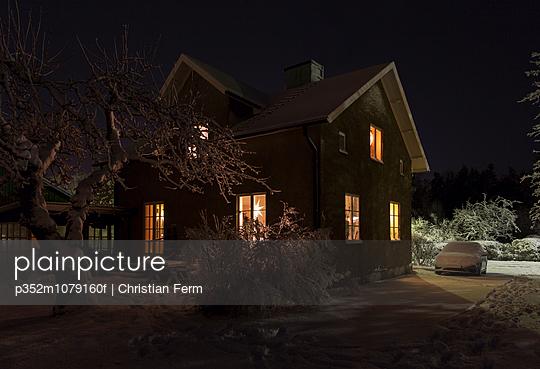 Sweden, Sodermanland, Jarna, House in winter at night