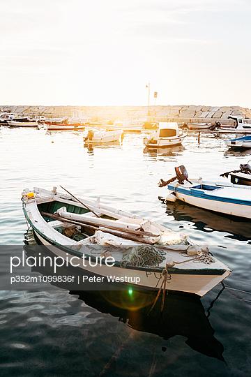Croatia, Istria, Row boat in marina at sunset