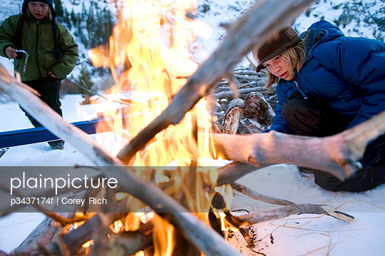 Two brothers start a campfire in the backcountry of California