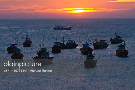 Fishing boats at sunset in habour in the port Mui Ne, Vietnam, Indochina, Southeast Asia, Asia