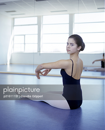 Sitting ballet dancer in pose