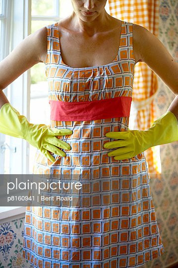 Housewife with cleaning gloves - routine