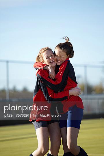 Team members hugging on field