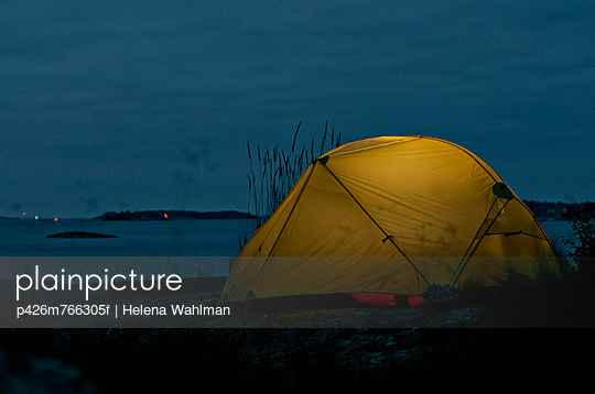 Tent by sea at night