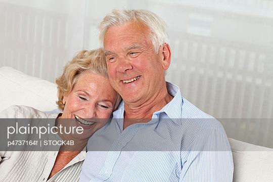Happy senior couple on sofa