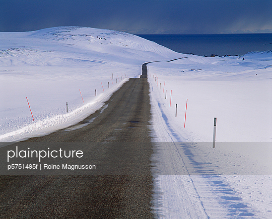 Road by snow-covered landscape