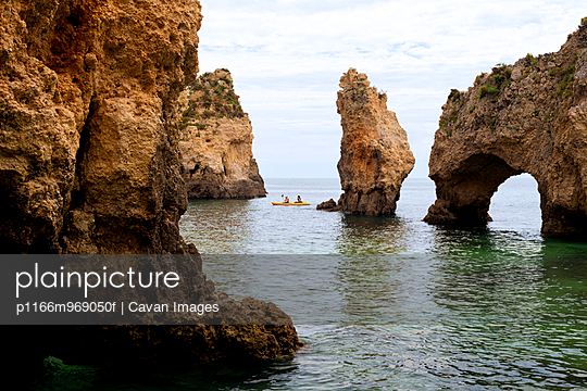 People Kayaking Along Rocky Southern Portugal Coast