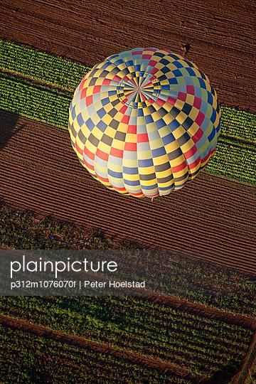 Hot air balloon above fields