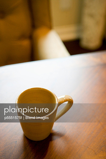 Empty coffee mug on wooden dining table