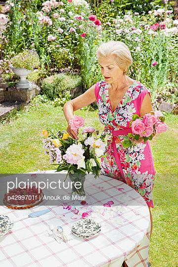 woman arranging flowers.