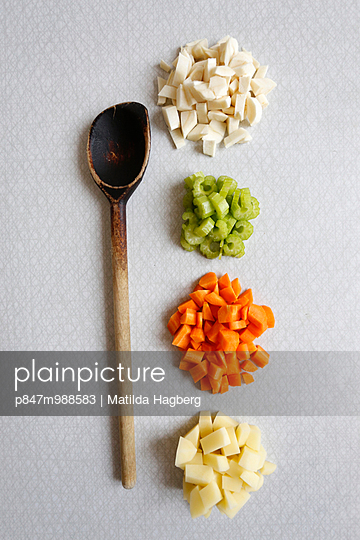 Vegetables finely cut in right beside a wooden spoon