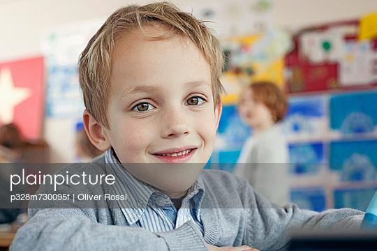 Portrait of happy young school boy (6-7)