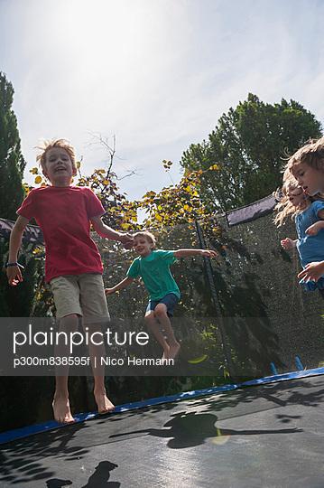 Children bouncing on trampoline
