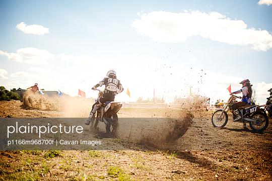 BMX Rider Kicking up Dirt in a Race