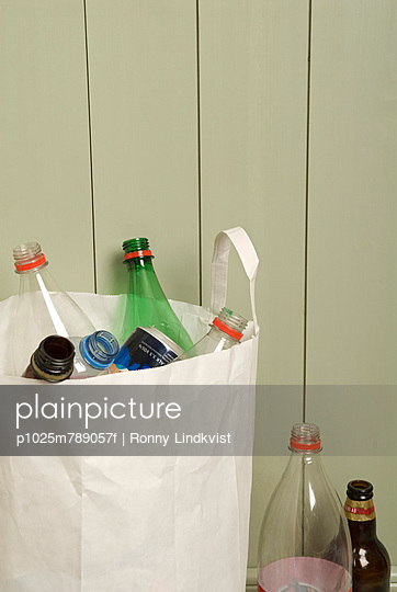 Close-up of PET bottles in white paper bag