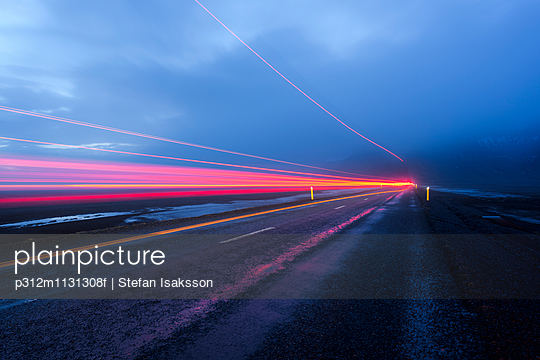 Light trail on road at dusk
