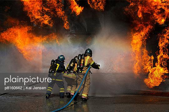 Firemen fighting wall of flames