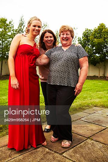 Portrait of three women laughing in garden