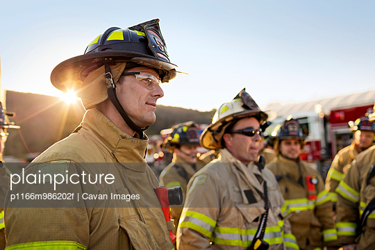 Fireman Smiling in a Group of Firefighters