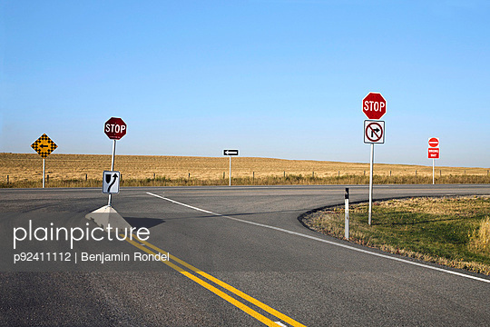 Signs on empty highway