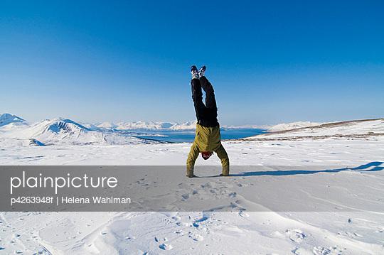 Acrobatic in winter landscape