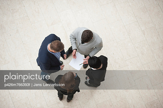 Directly above shot of four businesspeople in meeting