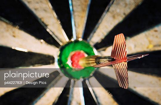 Dart in bulls eye of target
