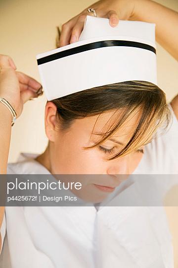 Nurse pinning on cap