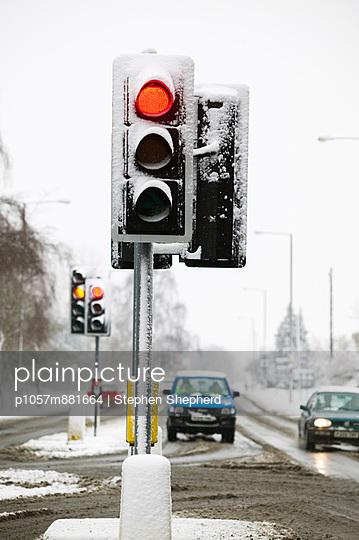 Red traffic light in winter