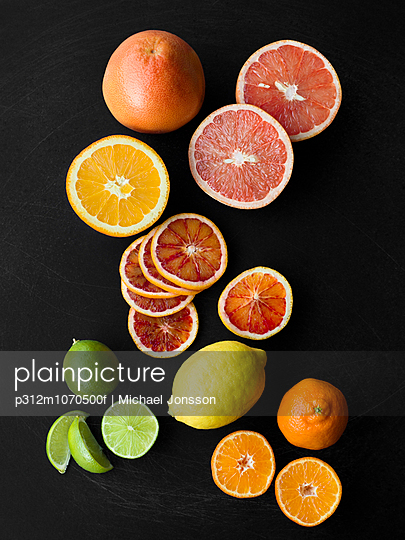 Citrus fruits on black background