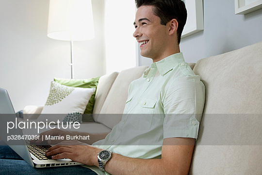 Man with laptop in living room