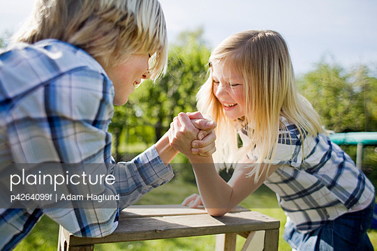 Siblings arm wrestling