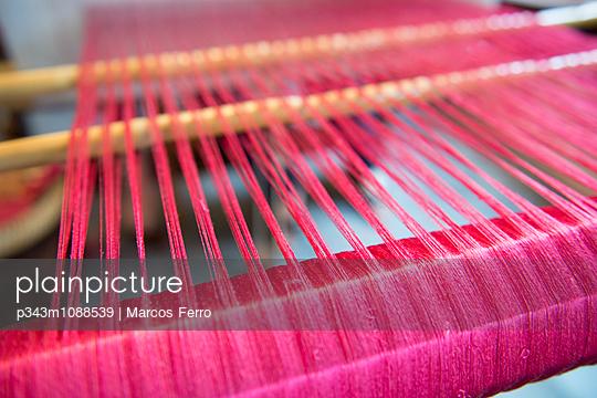 Rose coloured silk threads.