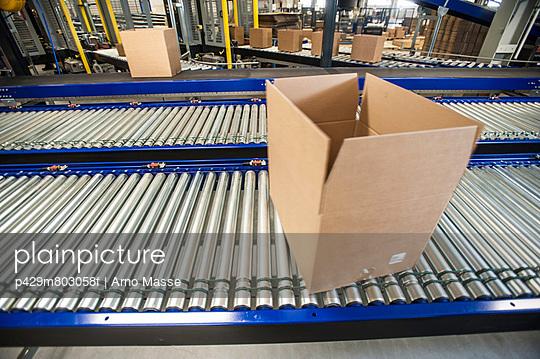 Empty box on moving conveyor belt
