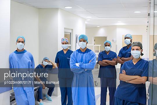 Team of doctors and nurses in hospital corridor