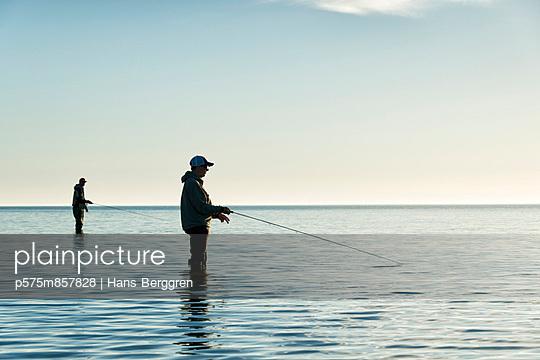 Men fishing at sea, Gotland, Sweden