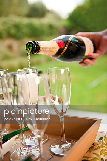Hand pouring champagne in glass