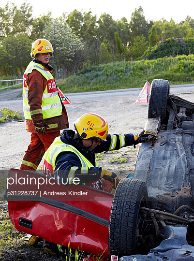 Firefighters rescue people from crashed car