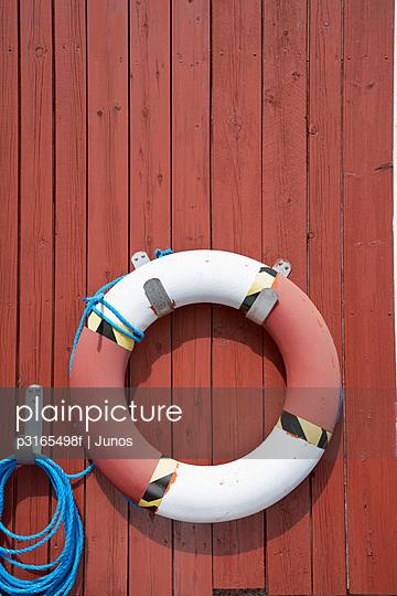 life buoy hanging on wall