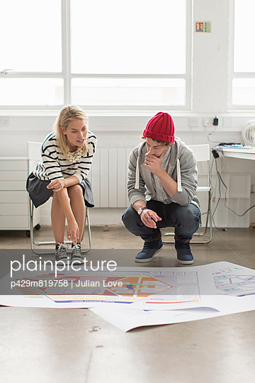 Young office workers discussing plans in creative office