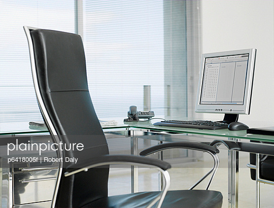 Empty office with chair and computer