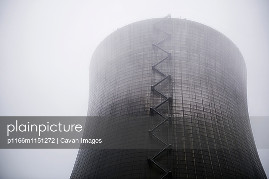 Low angle view of nuclear reactor in foggy weather