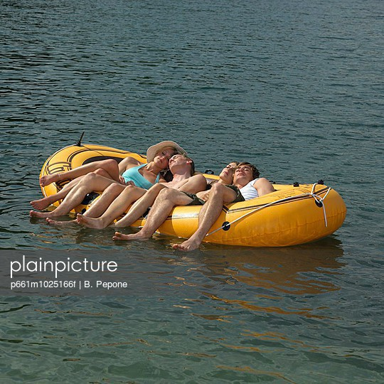 Four Young People in a Rubber Dinghy in Water