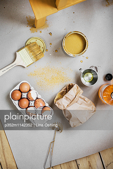 Sweden, Directly above view of paintbrush, wire whisk and cracked eggs