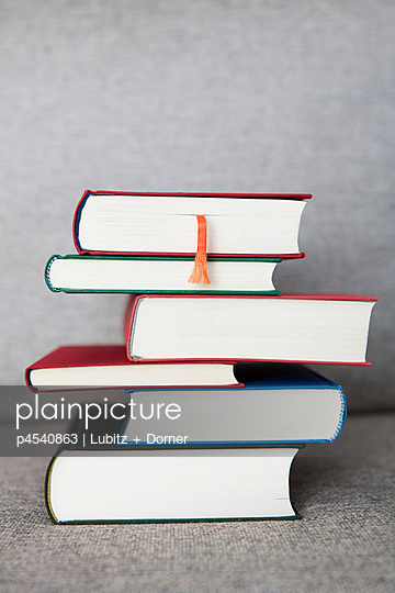 Stack of books on a sofa