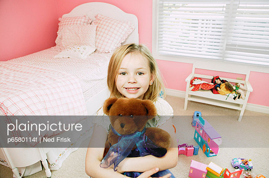 Little Girl with Teddy Bear in Bedroom