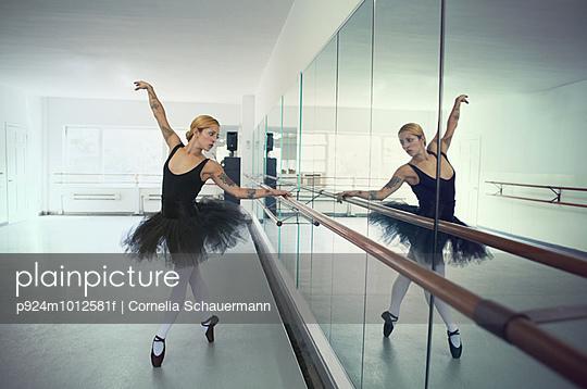 Ballet dancer practising in front of mirror