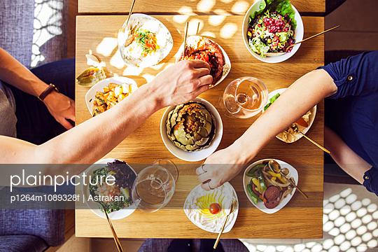 Directly above shot of couple eating meze at Lebanese restaurant